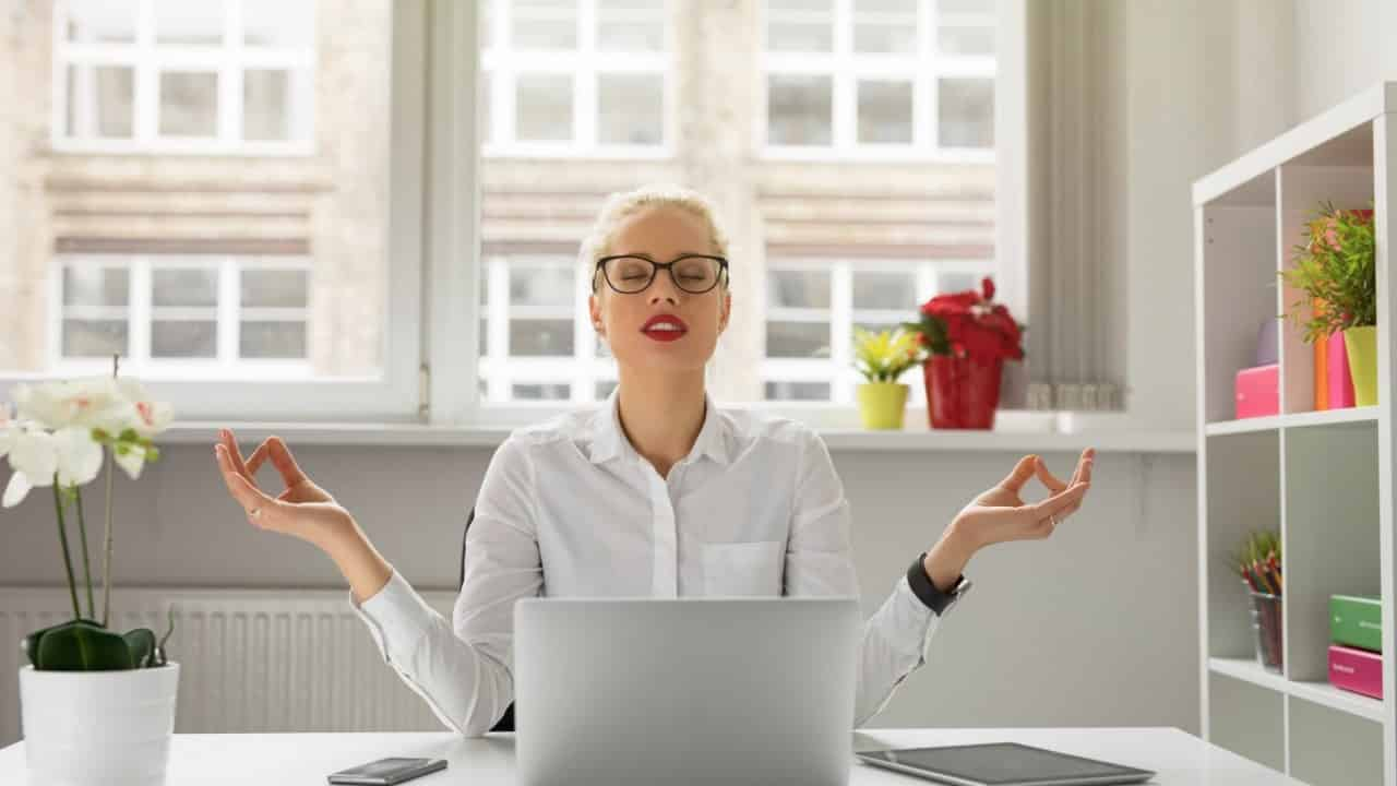 relaxed woman at office desk